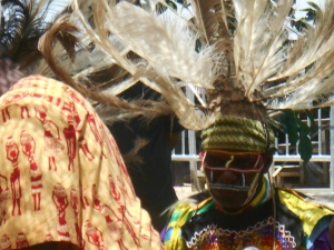 Kenyon Dancer with ostrich feather headpiece and beaded face piece
